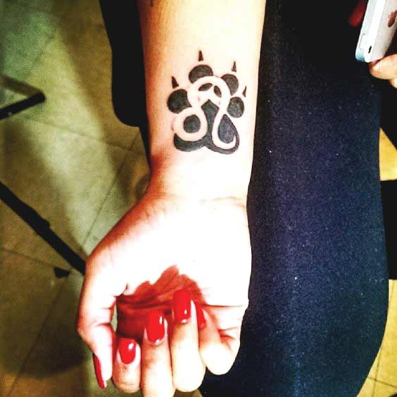 Lion paw and leo zodiac sign tattoo design on wrist