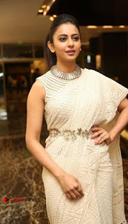 Actress Rakul Preet Singh Stills in White Dress at Winner Pre Release Function  0002.jpg