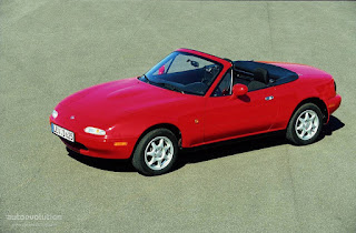 1997 Mazda Miata convertible, red paint, black convertible top
