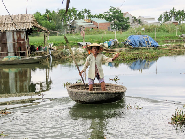 Vietnamese lady in a basket boat in Central Vietnam