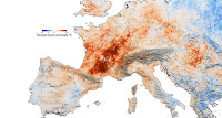 Climate change caused hundreds of heat-related deaths in London and Paris during the 2003 European heat wave, simulations suggest. Red regions experienced hotter July temperatures compared with those measured in 2001. (Credit: NASA) Click to Enlarge.