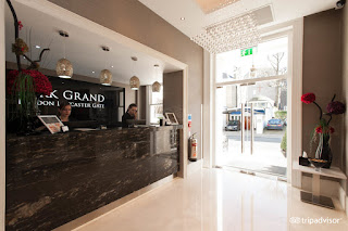 An image of the reception desk at the Park Grand