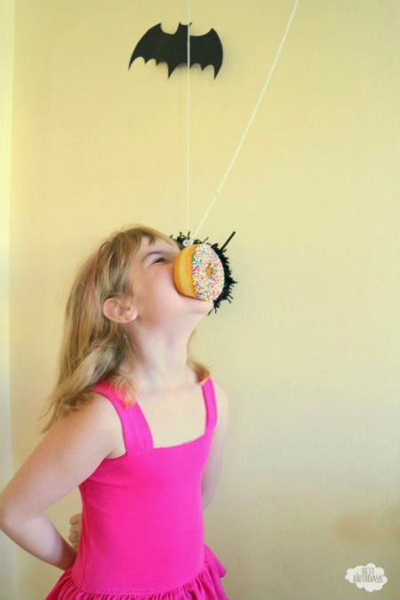 Easy Halloween Party Ideas - donut on a string! Click through for tons of other ideas for Halloween games and activities.