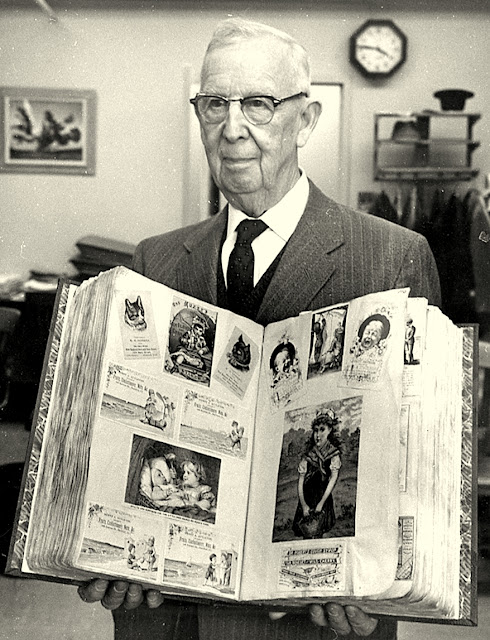 late 1950's black and white photo shows Earl J. Arnold in his Waltham MA Chamber of Commerce office
