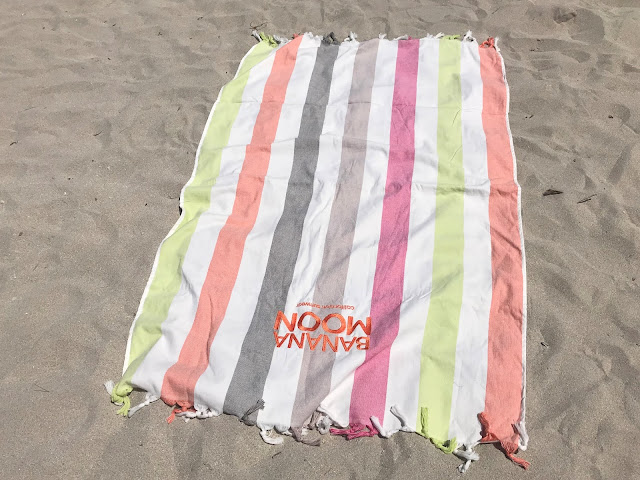 banana moon beach towel on the beach