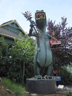 Godzilla clutching an Aermotor and a red convertible, by Patrick Amiot and Brigitte Laurent, Florence Avenue, Sebastopol, California