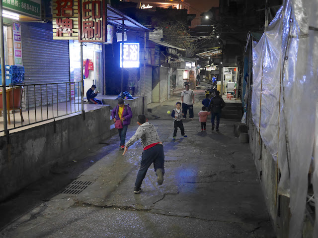 two boys and a man playing Gongbei-ball in Zhuhai