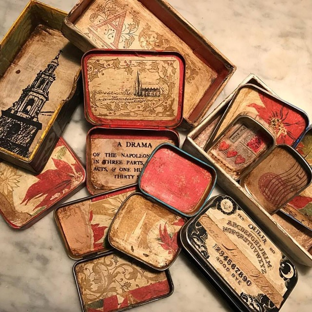 Altoids tins lined with paper and antique wax