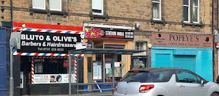 Bluto & Olive's barbers and Popeye's coffee shop in Portobello, Edinburgh