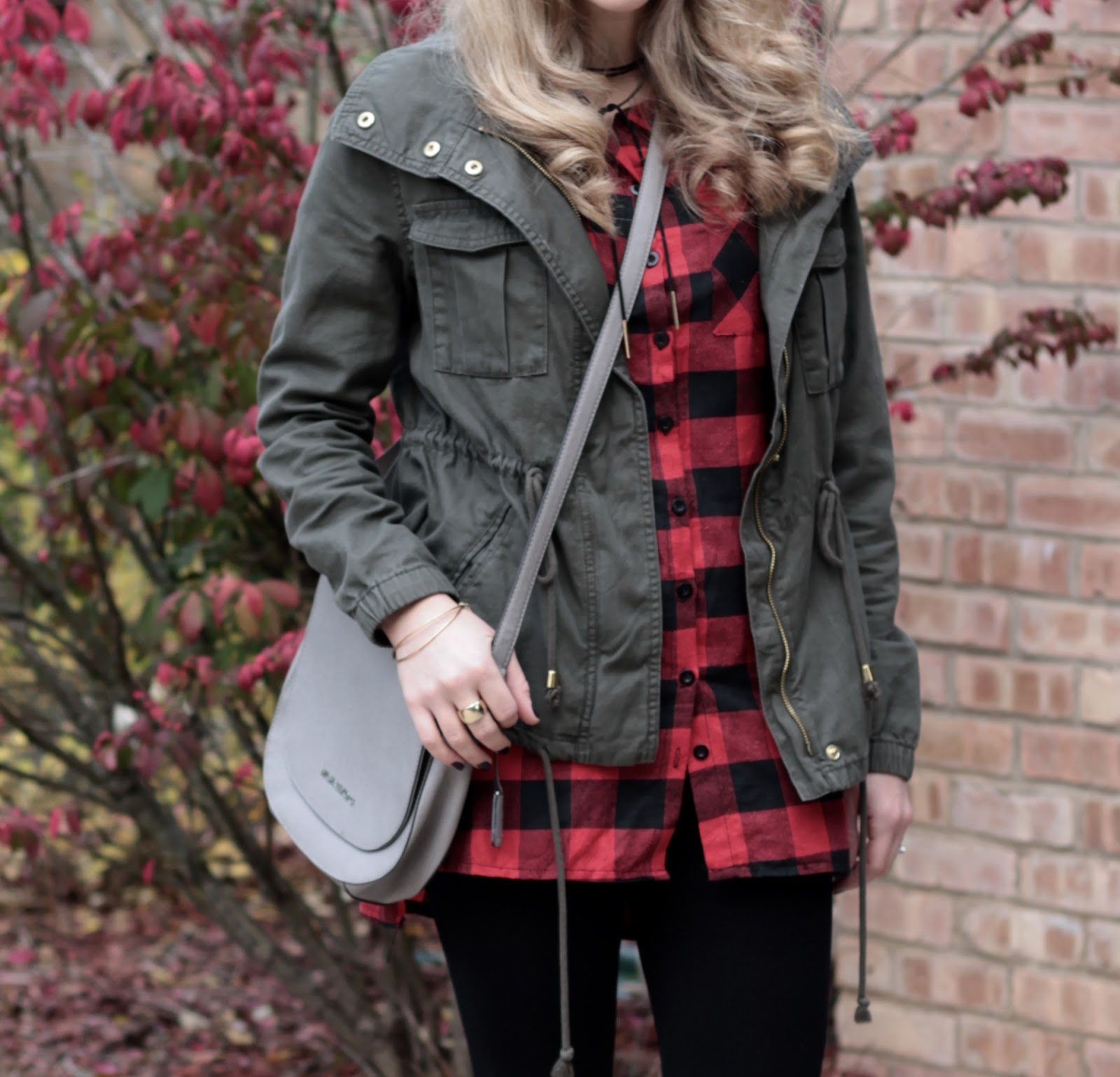 buffalo plaid button up, field jacket, leggings, white converse, saddlebag