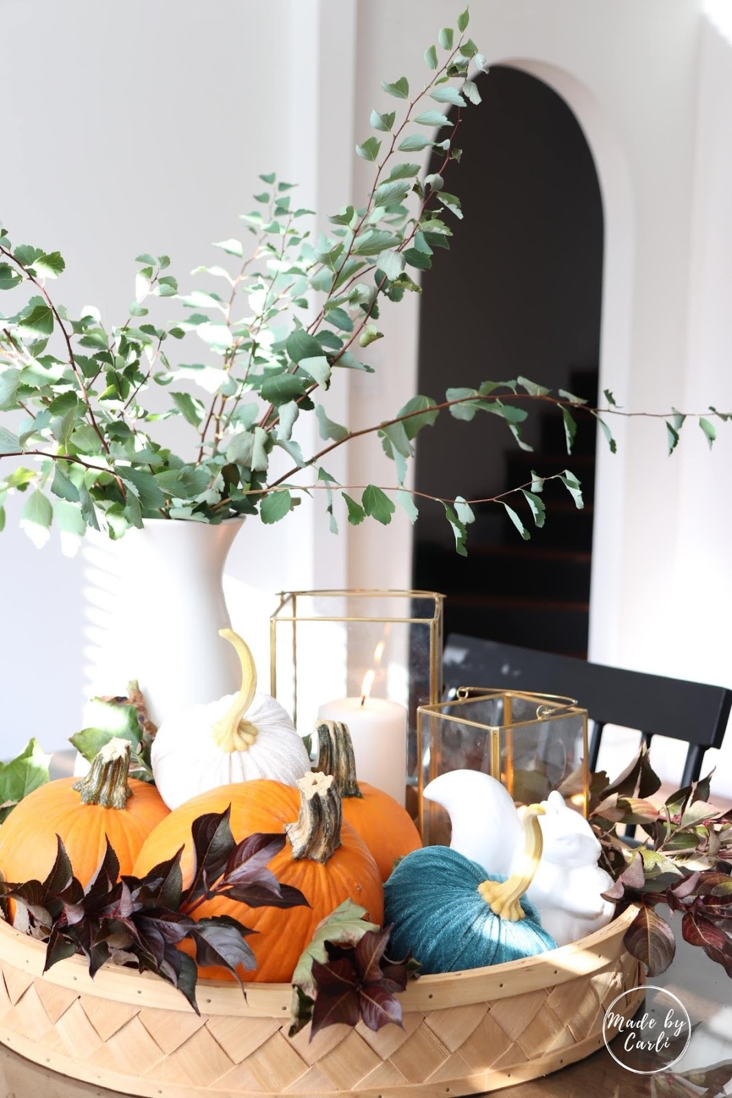 velvet pumpkins in basket with natural decor