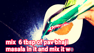 image of mixing pav bhaji masala in a grinded masala