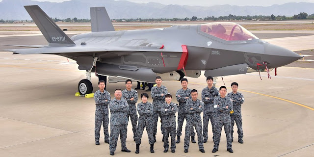 Image Attribute: The Japanese Air Self-Defense Force maintainers pose for a photo Nov. 28 during the arrival of the first Japanese F-35A at Luke Air Force Base Ariz. (U.S. Air Force photo by Tech. Sgt. Louis Vega Jr.) / Source: U.S. Department of Defense