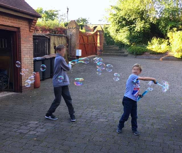 boys-playing-bubbles