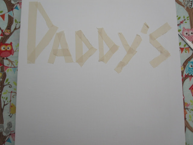 Canvas with lettering in masking tape