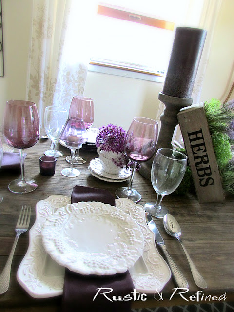 Modern dish tablescape using purple and white