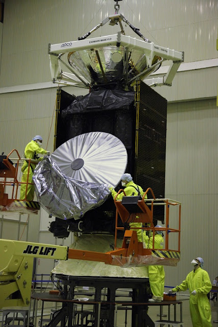 Removal of a protective cover from the high-gain antenna of the ExoMars 2016 Trace Gas Orbiter. Photo Credit: TsENKI