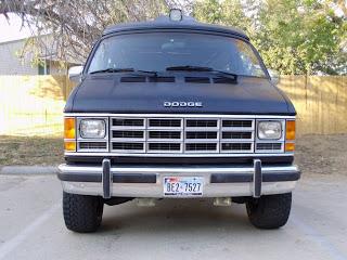 Front shot of the van painted with bedliner
