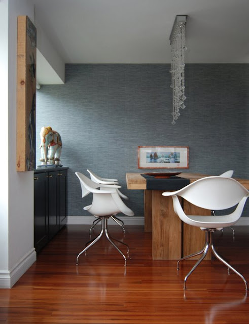 dining room with wood table and white plastic chairs