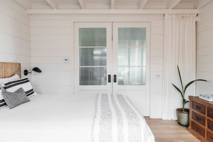 Gorgeous bedroom with shiplap in beautiful oceanfront cottage on Maui - found on Hello Lovely Studio