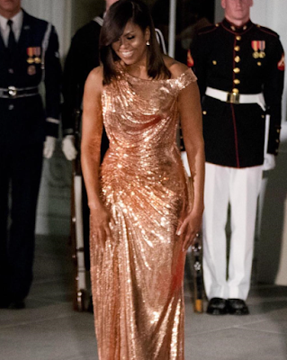 Michelle Obama stuns in a custom-made Versace gown for Barack Obama's last state dinner