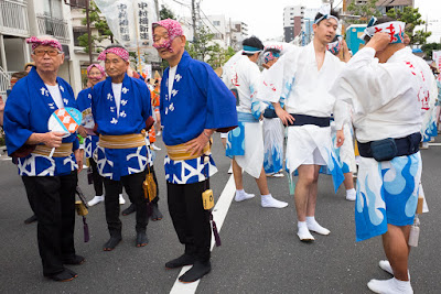 Participants from different groups wait for the 60th Koenji Awa-Odori Parade to start.