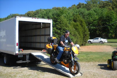Motorbike unloading from a Trailer