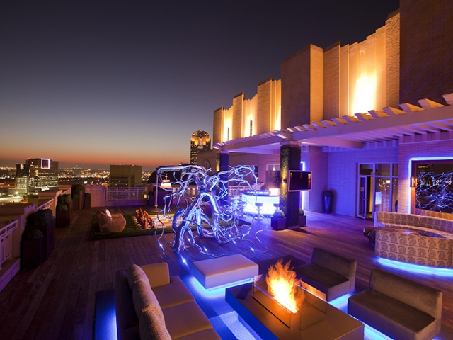 Photo of penthouse terrace at night with the city views