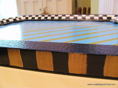 black and gold stripes on painted tray