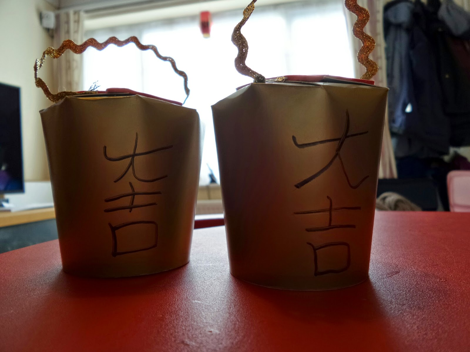 A Chinese Money Cup with Good Fortune written on it