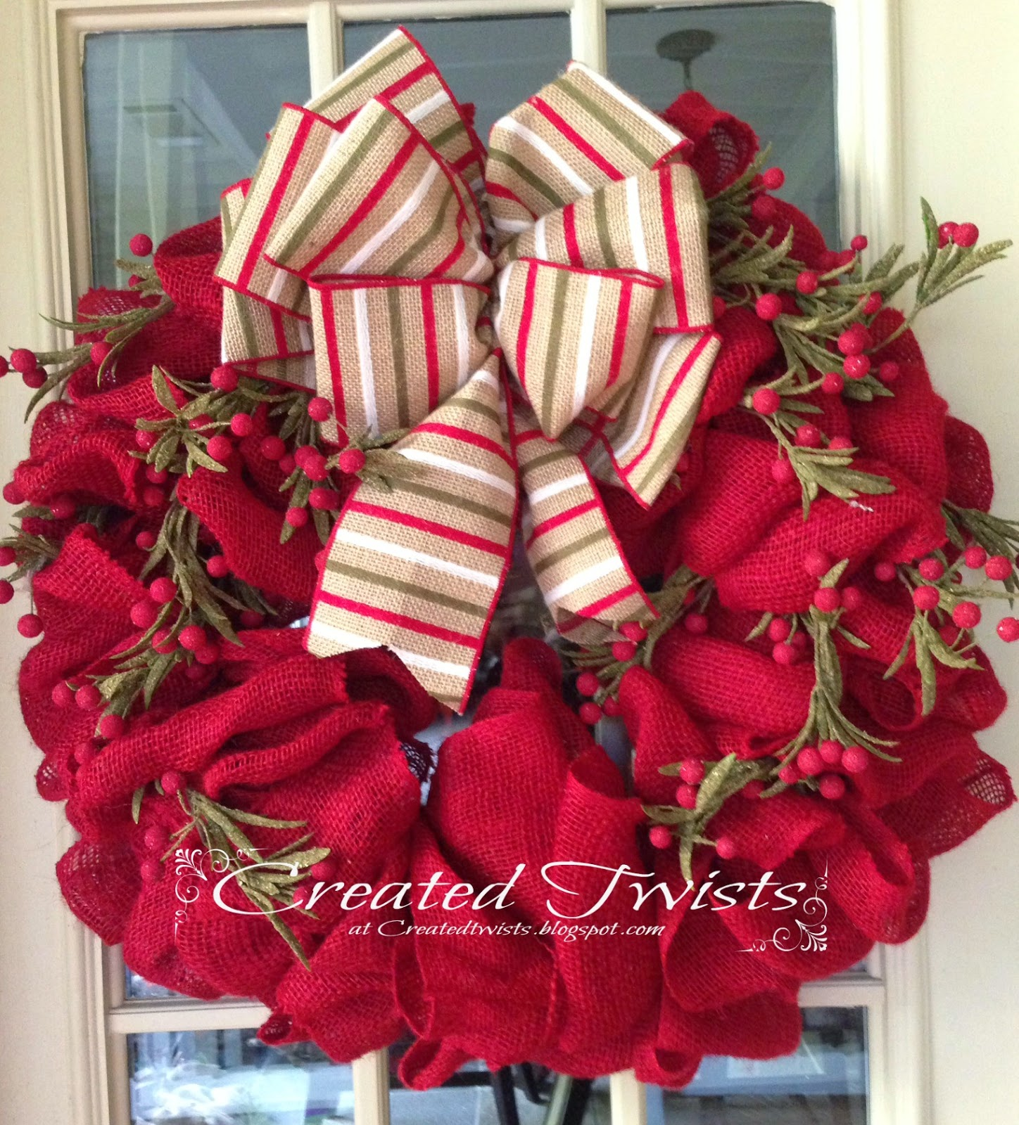 Created twists red burlap christmas wreath with striped for Burlap wreath with lights