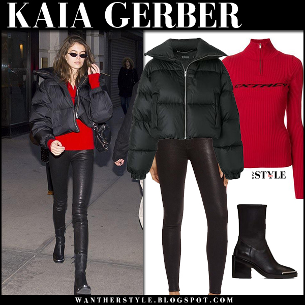 Kaia Gerber in black puffer down jacket misbhv, red sweater and black leather pants hudson street fashion february 5