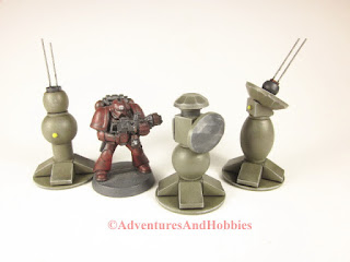 Group of military field tech devices for 25 to 28 mm scale science fiction war games and role-playing games.