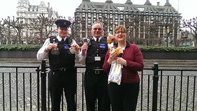 Security guards with cat-themed biscuits