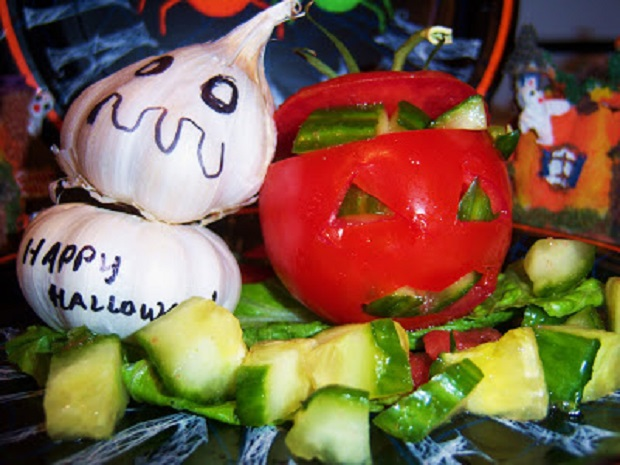 this is a photo of garlic ghost and tomato puking for a Halloween Party gag