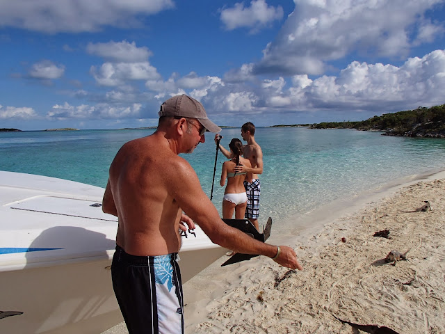 Ron feeding iguanas