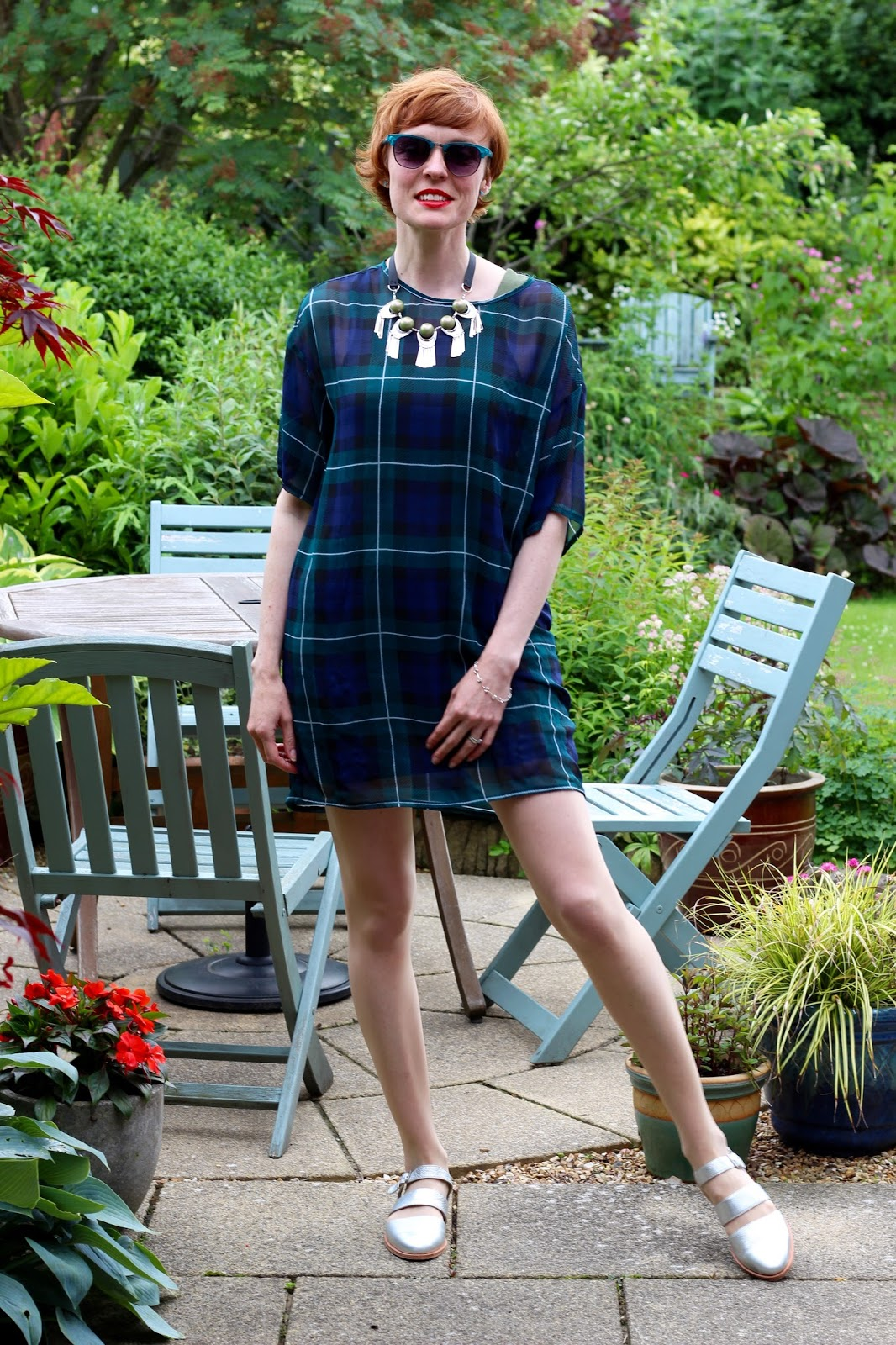 Fake fabulous | Tartan T-shirt dress, silver sandals and red lips.