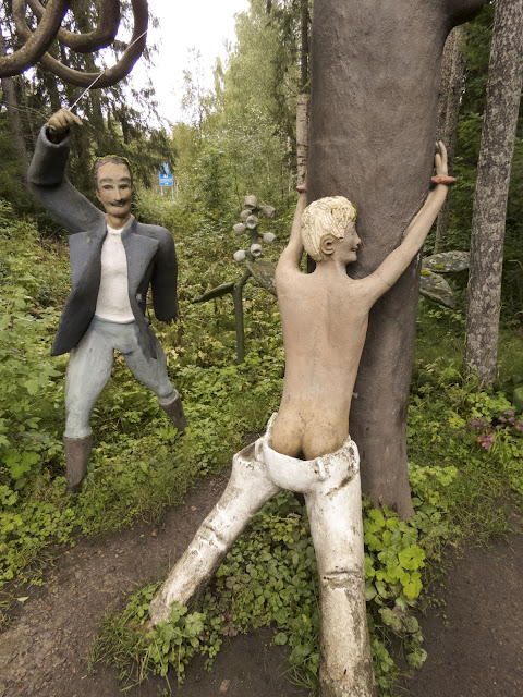 Sculpture of a man whipping another man at Parikkala Sculpture Park in Finland