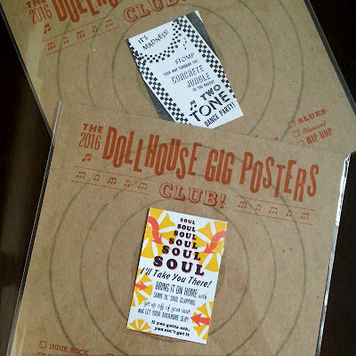 Detail of two dollhouse gig posters on their presentation cards.