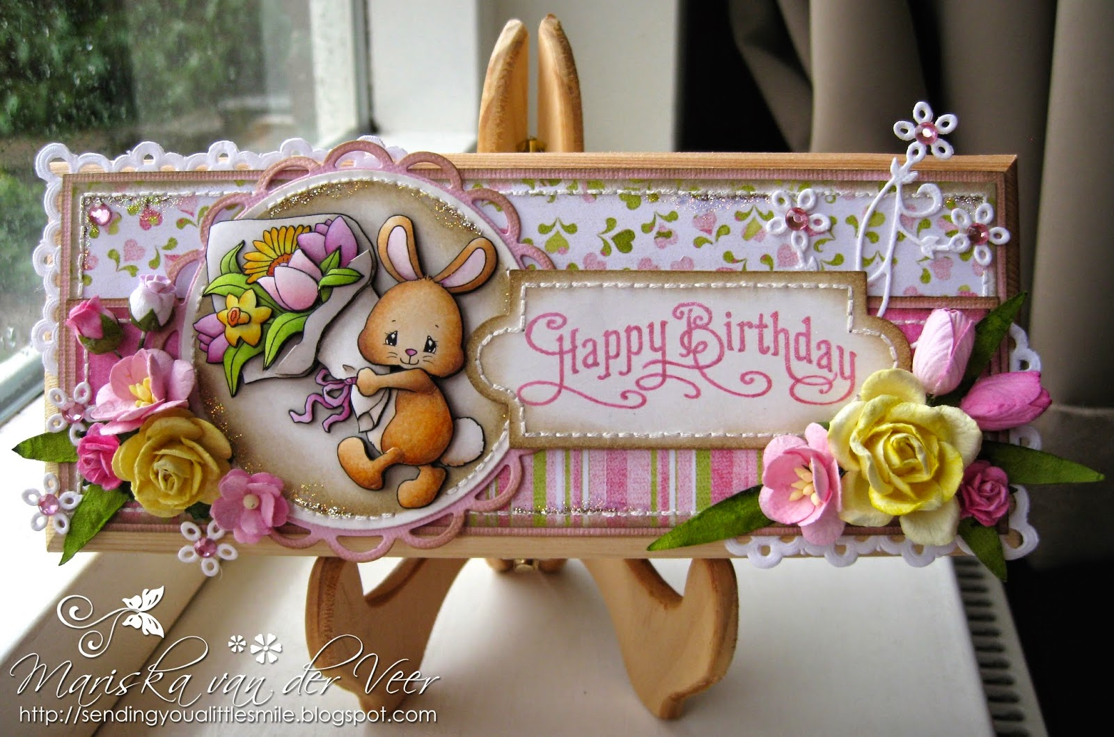 Bunny With Flowers On A Birthday Gift Box