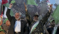 Hamas Prime Minister Ismail Haniyeh with released Palestinian prisoner Mohammed Al Hasani