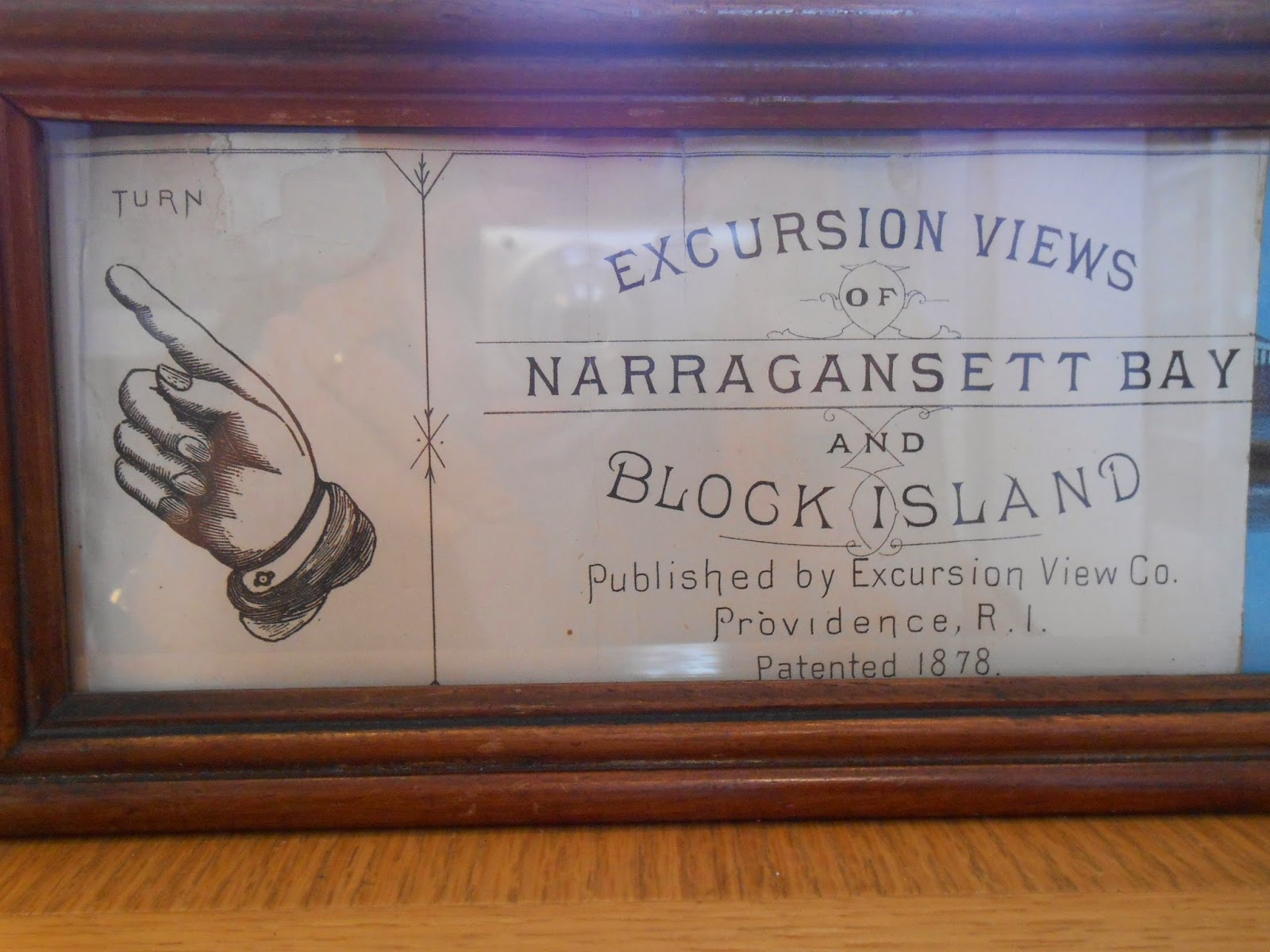 "Another view of the scroll, advertising ""Excursion Views of Narragansett Bay and Block Island."""