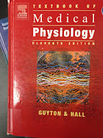 Textbook of Medical Physiology, by Guyton and Hall, superimposed on Intermediate Physics for Medicine and Biology.