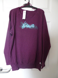red wine coloured jumper with long sleeves