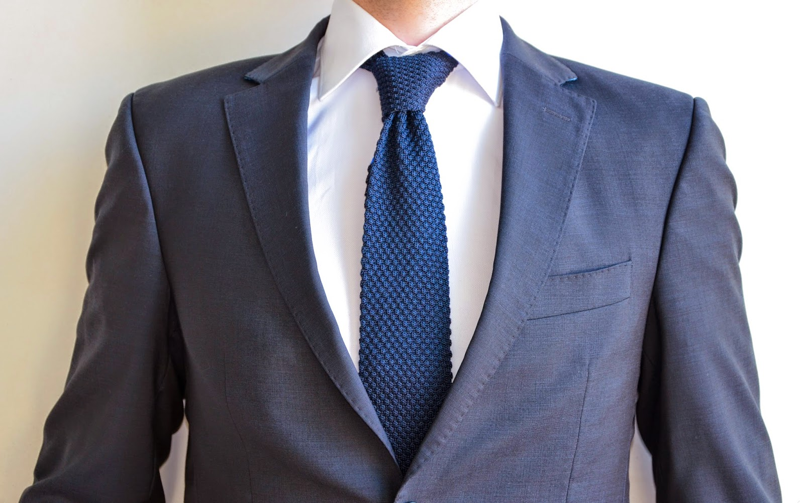 Black suit dark blue tie