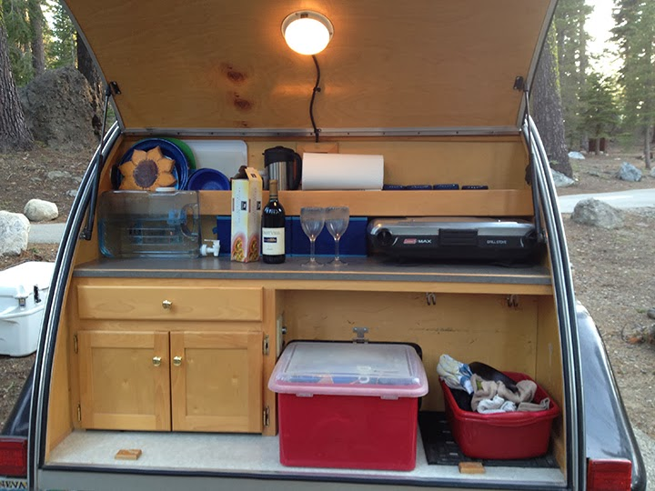 Tiny yellow teardrop how do you wash your dishes for Teardrop camper kitchen ideas