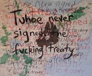 An art work - tuhoe never signed the fucking treaty is repeatedly scribbled in different colours on a map of New Zealand