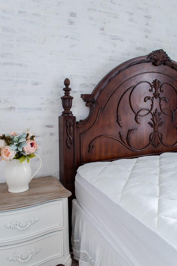 contrast dark headboard against white brick