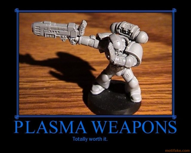Warhammer Soldier figurine that is aiming a large weapon and simultaneously shielding his eyes