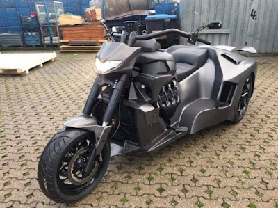 "Fiery motorcycle with a ""half"" Lamborghini car"